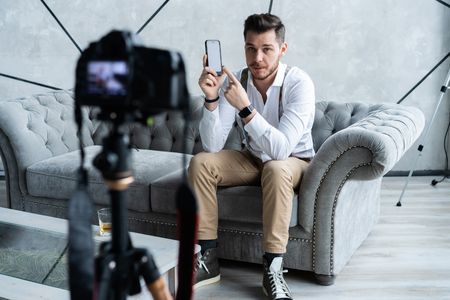 Young male blogger recording video at home. Stock Photo - 116097747