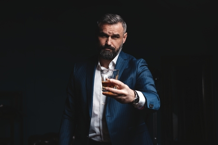 Attractive man with cigar and a glass whiskey Stok Fotoğraf