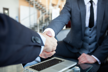 Business people shaking hands, finishing up a meeting. Reklamní fotografie