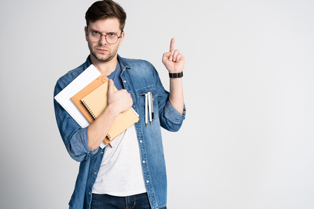 I have got brilliant idea. Caucasian cheerful man, raises index finger, has intriguing plan isolated over white background with copy space Stock fotó