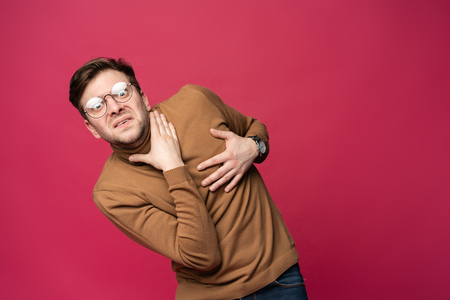 Im afraid. Fright. Portrait of the scared man isolated on trendy pink studio background. Male half-length portrait. Human emotions, facial expression concept Stok Fotoğraf