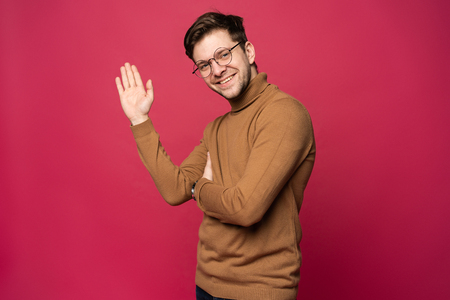 Portrait of smiling man with hand raised in greeting. High five conceptÑŽ 스톡 콘텐츠