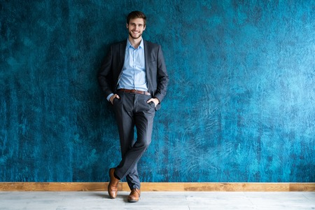 Smiling businessman full length portrait Stock Photo