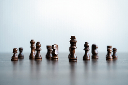 Chess figures on chessboard. concept of business strategy and tactic.