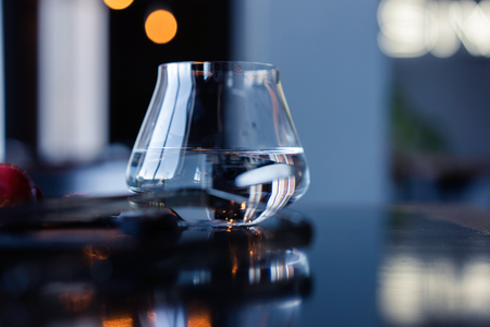 glass of water on a table in a cafe.