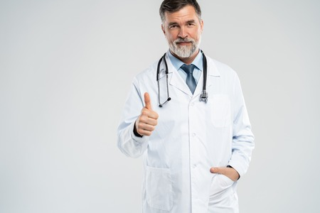 Happy smiling doctor with thumbs up gesture, isolated on white background. Imagens