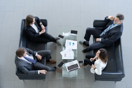 Top view of working business group sitting at table during corporate meeting. Stock fotó