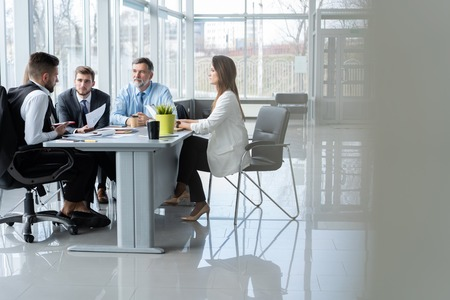 Businesspeople discussing together in conference room during meeting at office. Standard-Bild - 122935658