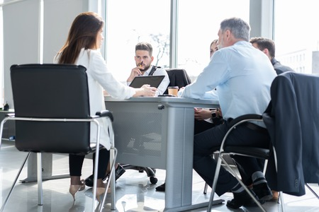 Businesspeople discussing together in conference room during meeting at office. Standard-Bild - 122935659
