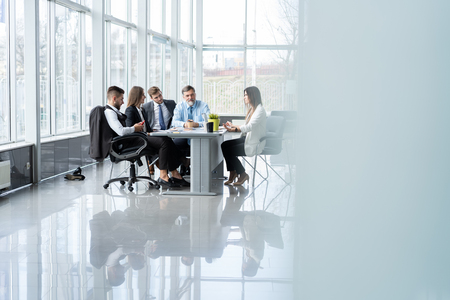 Businesspeople discussing together in conference room during meeting at office. Standard-Bild - 122935689