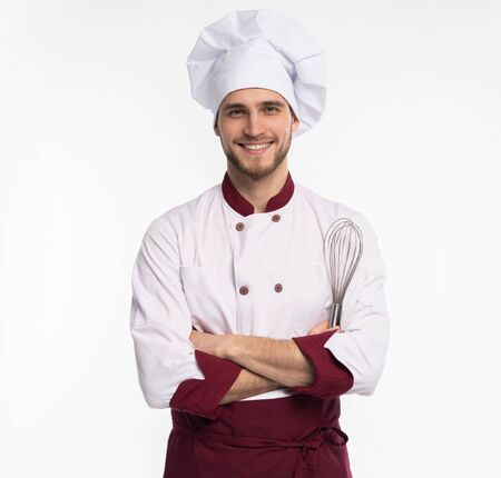 Portrait of positive handsome chef cook in beret and white outfit isolated on white background.