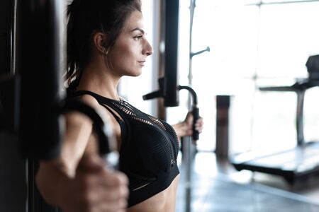 beautiful muscular fit woman exercising building muscles