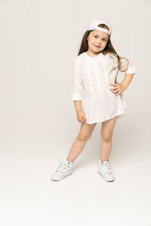 Cute girl 5-6 year old posing in studio. 写真素材