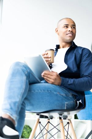 happy african american entrepreneur using tablet computer.