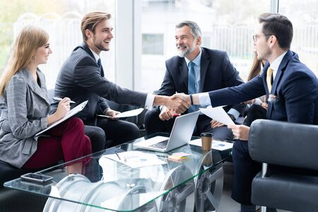 Business people shaking hands, finishing up a meeting. Handshake. Business concept.
