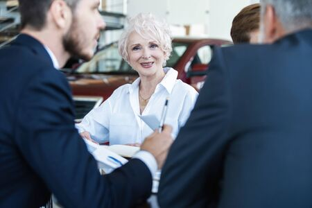 Confident mature business woman leader coach speaking at meeting negotiations