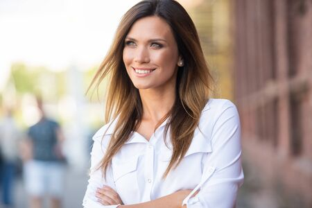 Portrait of a successful business woman smiling Stock Photo