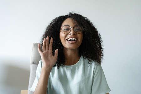 Head shot portrait friendly talking mixed race woman, looking at camera, making video call, recording vlog or webinar Reklamní fotografie