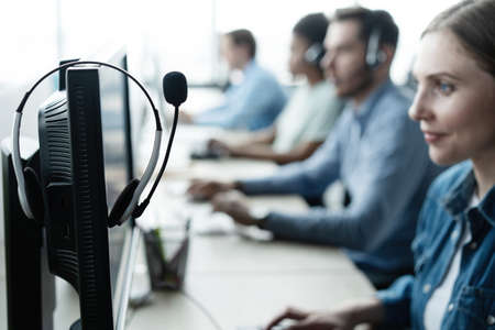 Communication support, call center and customer service help desk at modern office.