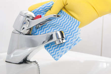 Cleaning Tap with Rubber Gloves Stock Photo