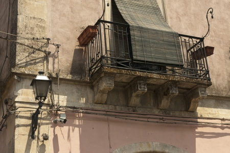 Balcony Covered against Heat and Sunshine in Sicily Stock Photo