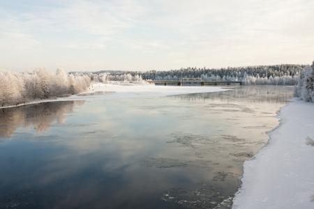 Railroad Bridge Crossing Freezing River Stock Photo