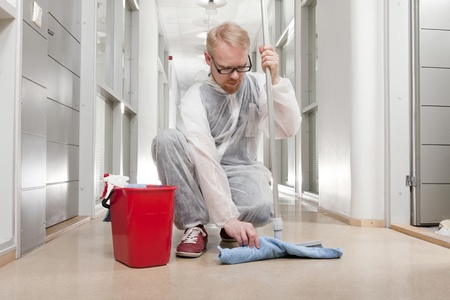 Man in Overall Preparing Mop to Clean Office Corridor