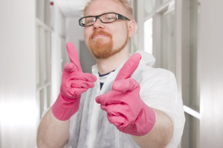 Man in Overall Pointing with Image Focus on Fingers Stock Photo