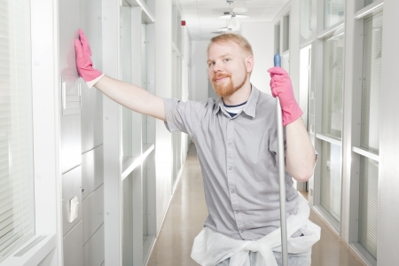 Man Leaning at Corridor Just Cleaned