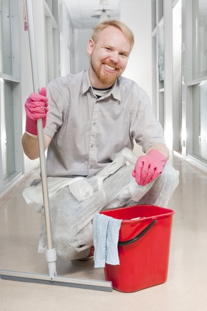 Cleanser Posing with Spatula and Cleaning Equipment