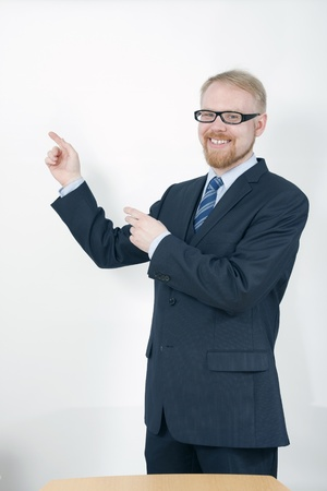 Businessman Holding Presentation and Pointing at Screen