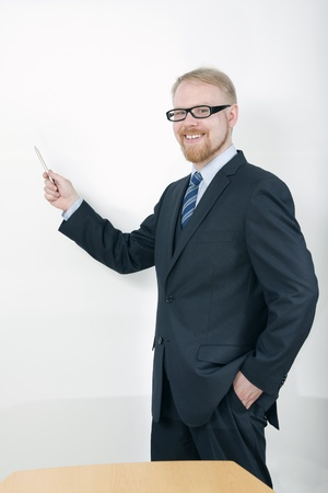 Businessman Holding Presentation and Pointing Screen with Pen Stock Photo