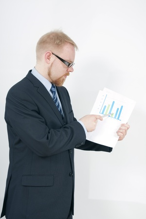 net income: Businessman Pointing Graph with Pen infront of Display Screen