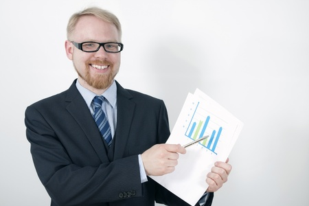 Businessman Pointing Graph with Pen infront of Projection Screen