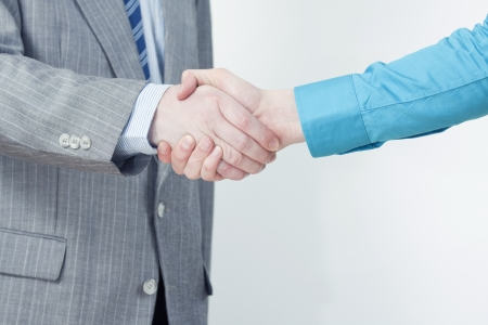 Official and Casual Man Shaking Hands Stock Photo