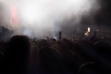 Silhouettes of People Rocking in Front of Stage.