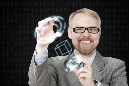 Man in Suit Handling 3D Virtual Mesh photo