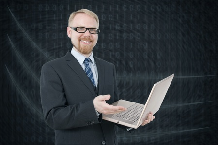 Man in Suit Holding Laptop photo
