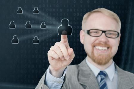 Smiling Man Selecting Virtual Icon, Focus at Fingertip