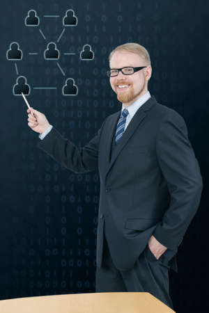 Man in Suit Presenting Social Network in Front of Table Stock Photo - 21024316