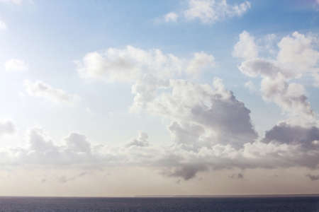 Cloudscape of Cumulus Clouds over Sea in Pastel Colors