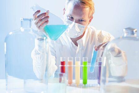 Cyan Liquid in Test Tube and In Big Flask