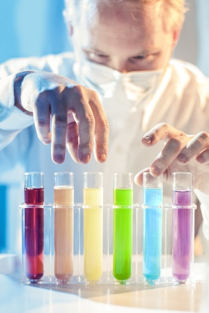 Scary Scientist Picking Different Colored Samples