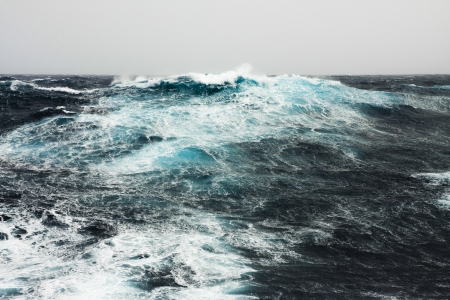 storming: Huge Wave Crashing Down at Storming North Atlantic Stock Photo