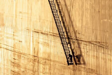 Man Working in The End of a Long Gangway Lowered By a Ship