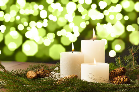 Christmas Candle Setting with Bokeh Background Stock Photo