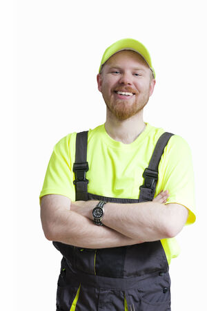 Smiling Construction Worker Standing and Smiling Stock Photo