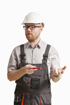 Construction Foreman Pointing with Pencil in Proposing Expression photo