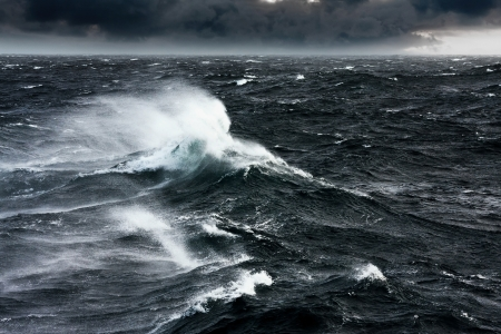 storm clouds: Waves Breaking and Spraying at High Seas and Strong Winds