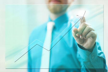 Man in Suit Pointing Tip of Virtual Screen Arrow photo